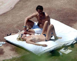 Sharon Stone topless @ the beach